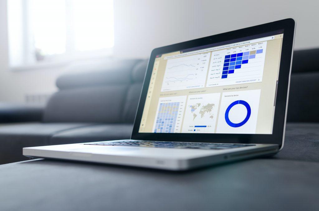 computer on sofa showing analytics